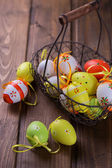 Colorful easter eggs in bucket — Stock Photo