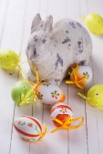 Colorful easter eggs and rabbit — Stock Photo