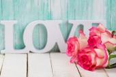 Postcard with elegant  flowers and word love — Stock Photo