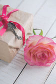 Flower rose on box with present — Foto de Stock