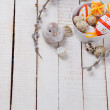 Easter eggs in bucket and willow branches — Stock Photo #68054981