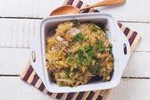 Homemade sauerkraut in bowl with herbs — Stock Photo