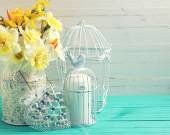 Background with fresh daffodils  and decorative heart — Stock Photo