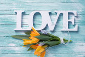 Fresh flowers and word love — Stock Photo
