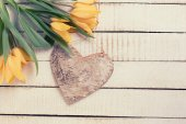 Background with fresh tulips and heart — Stock Photo