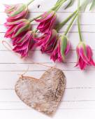Background with pink tulips and heart — Stock Photo
