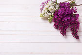 Lilac flowers on wooden background. — Stock Photo