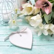 Background with flowers, heart  and candles — Stock Photo #74083491