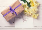 Gift box, flowers and empty tag — Stock Photo