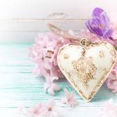 Background with flowers and decorative heart — Stock Photo