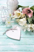 Background with flowers, heart  and candles — Stock Photo