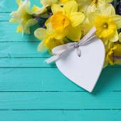 Yellow and blue flowers and decorative heart — Stock Photo