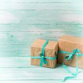 Festive gift boxes with ribbon — Stock Photo