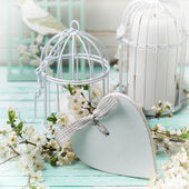 Tree branches, heart and decorative bird — Stock Photo