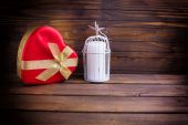 Festive gift box and candle — Stock Photo