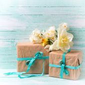Festive gift boxes with ribbon and flowers — Stock Photo
