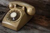 Vintage Telephone on an Old Wood Table — Stok fotoğraf
