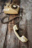Vintage Telephone on an Old Wood Table — Stock Photo