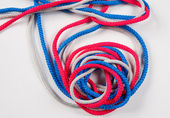 Three colorful twisted sewing strings — Stock Photo
