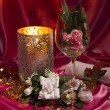 Candle, wineglass and necklace — Stockfoto #58428935