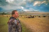 A man and a herd of goats and sheep — Stock Photo