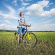 Portrait of a boy with a bicycle — Stock Photo #53933273