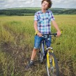 Portrait of a boy with a bicycle — Stock Photo #53933293