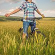 Portrait of a boy with a bicycle — Stock Photo #53933297