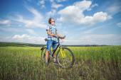Portrait of a boy with a bicycle — Stock Photo