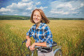 Portrait of a girl with a bicycle — Stock Photo