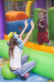 Girl in a mask of a clown at children's parties is playing with  — Stock Photo