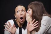 Daughter shares a secret with her mother — Fotografia Stock