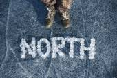 Word North, composed of pieces of ice on the frozen lake  — Стоковое фото