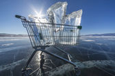 Shopping trolley full of clear ice on a frozen lake — Foto Stock
