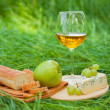 Still life with white wine, baguette, cheese, grape and apple — Stock Photo #52490237