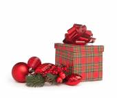 Red christmas present with bow, mistletoe and toys  — Stock Photo