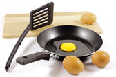 Eggs and teflon skillet — Stock Photo