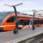 Modern European train at railway station — Stock Photo #62098875