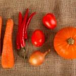 Fresh autumn vegetables lie on sacking — Stock Photo #58769415