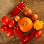 Fresh autumn vegetables lie on sacking — Stock Photo #58769461