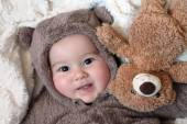 Baby in costume bear with toy bear — Stock Photo