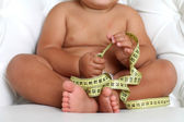 Adorable Baby Boy with a measuring tape — Stock Photo