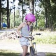Child with pink bicycle helmet learning to bike — Stock Photo #53215407