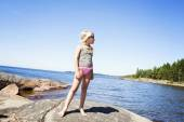 Child on rocky beach in Sweden — Stock Photo