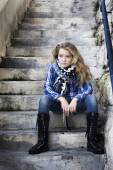 Lonely strong girl sitting on staircase — Stockfoto
