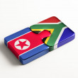 South Africa North Korea Puzzle Concept — Stock Photo #56969533