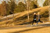 Friends jogging in park — Stock Photo