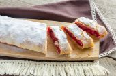 Cherry strudel on the wooden board — Stock Photo
