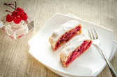 Cherry strudel on the square plate — Stock Photo