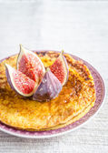 Pile of pumpkin crepes decorated with fresh fig — Stock Photo